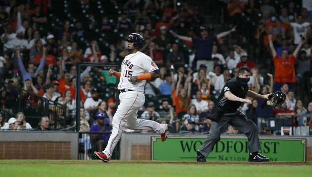 Houston Astros Martin Maldonado (15) scores a run on Yordan Alvarez's RBI single during the seventh inning of an MLB baseball game at Minute Maid Park, Tuesday, June 1, 2021, in Houston. Photo: Karen Warren/Staff Photographer / @2021 Houston Chronicle