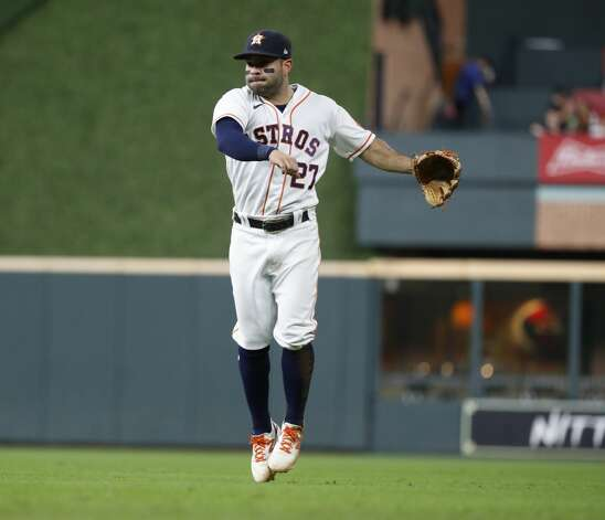 Houston Astros second baseman Jose Altuve (27) watches his throw go to first base as Boston Red Sox Marwin Gonzalez ground out during the seventh inning of an MLB baseball game at Minute Maid Park, Tuesday, June 1, 2021, in Houston. Photo: Karen Warren/Staff Photographer / @2021 Houston Chronicle