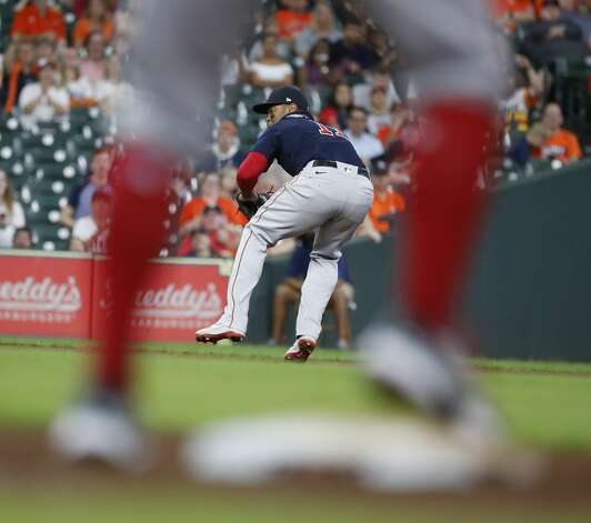 Houston Astros Chas McCormick (20) reaches base after Boston Red Sox third baseman Rafael Devers'throwing error during the seventh inning of an MLB baseball game at Minute Maid Park, Tuesday, June 1, 2021, in Houston. Photo: Karen Warren/Staff Photographer / @2021 Houston Chronicle