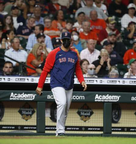 Boston Red Sox manager Alex Cora walk out to pull relief pitcher Hirokazu Sawamura during the seventh inning of an MLB baseball game at Minute Maid Park, Tuesday, June 1, 2021, in Houston. Photo: Karen Warren/Staff Photographer / @2021 Houston Chronicle