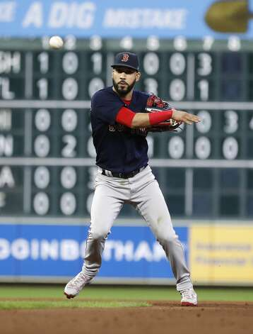Boston Red Sox second baseman Marwin Gonzalez over throws the ball as Houston Astros Myles Straw reached first base on the error during the seventh inning of an MLB baseball game at Minute Maid Park, Tuesday, June 1, 2021, in Houston. Photo: Karen Warren/Staff Photographer / @2021 Houston Chronicle