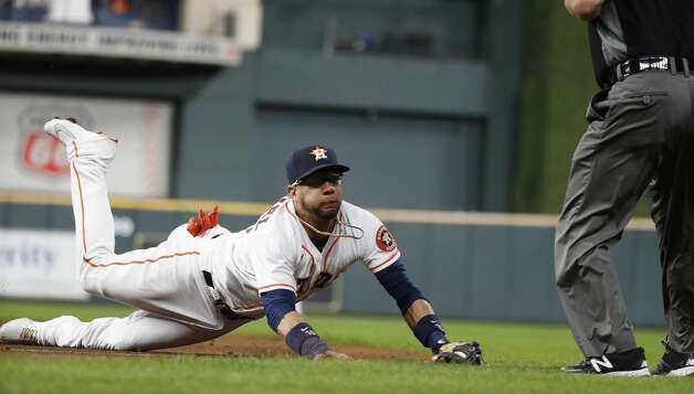 Houston Astros first baseman Yuli Gurriel (10) makes a diving catch on Boston Red Sox Danny Santana's single during the fifth inning of an MLB baseball game at Minute Maid Park, Tuesday, June 1, 2021, in Houston. Photo: Karen Warren/Staff Photographer / @2021 Houston Chronicle