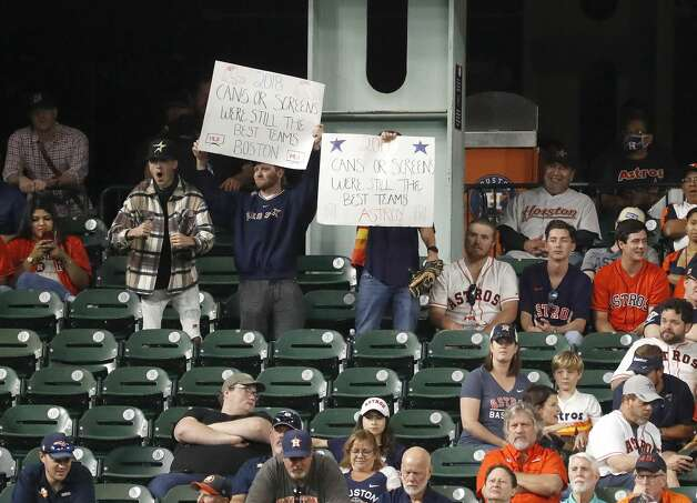 Fans with dueling signs in the Crawford Boxes during the ninth inning of an MLB baseball game at Minute Maid Park, Tuesday, June 1, 2021, in Houston. Photo: Karen Warren/Staff Photographer / @2021 Houston Chronicle