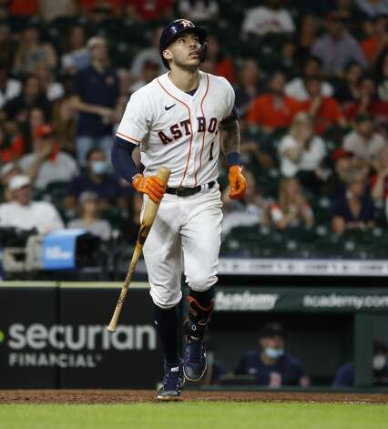 Houston Astros Carlos Correa (1) watches his fly out ending the eighth inning of an MLB baseball game at Minute Maid Park, Tuesday, June 1, 2021, in Houston. Photo: Karen Warren/Staff Photographer / @2021 Houston Chronicle