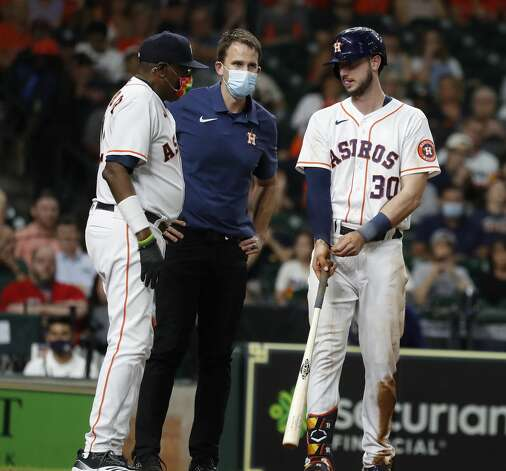 Houston Astros manager Dusty Baker Jr. (12) and trainer Jeremiah Randall check on Kyle Tucker (30) after he fouled a ball off his leg during the eighth inning of an MLB baseball game at Minute Maid Park, Tuesday, June 1, 2021, in Houston. Photo: Karen Warren/Staff Photographer / @2021 Houston Chronicle
