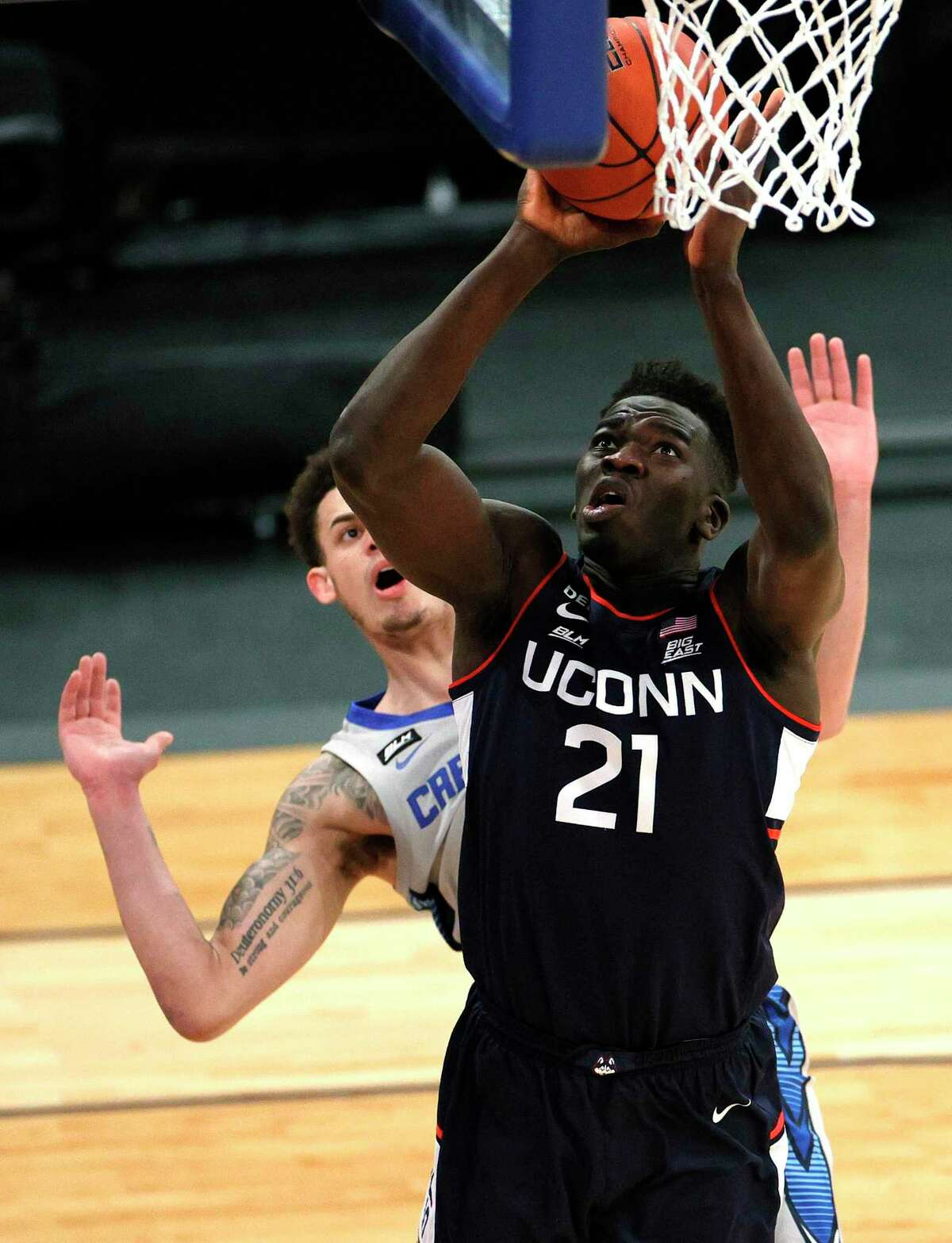 NEW YORK, NEW YORK - MARCH 12: Adama Sanogo # 21 of the Connecticut Huskies goes to the basket in the first half against the Creighton Bluejays in the Big East Tournament Semifinals at Madison Square Garden on March 12, 2021 in New York City.  (Photo by Sarah Stier / Getty Images)