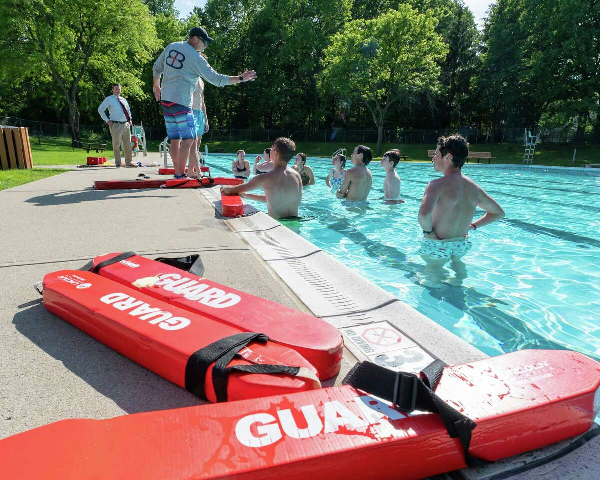 Brian Czerpak teaches a certification class to prospective lifeguards at the Country Knolls Pool while town Supervisor Phil Barrett looks on in Clifton Park, NY, on Tuesday, June 1, 2021 (Jim Franco/Special to the Times Union)