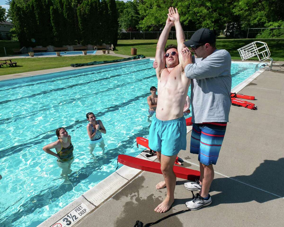 Brian Czerpak (right) and James Altenburger teach a certification class to prospective lifeguards at the Country Knolls Pool in Clifton Park, NY, on Tuesday, June 1, 2021 (Jim Franco/Special to the Times Union)
