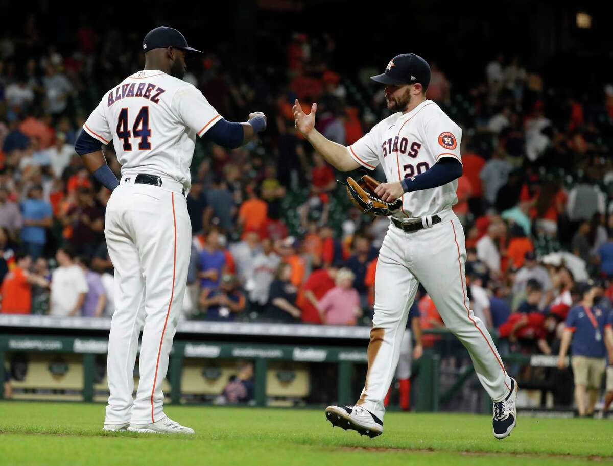 Houston Astros Yordan Alvarez (44) and Chas McCormick (20) celebrate the Astros 5-1 win over the Boston Red Sox after the ninth inning of an MLB baseball game at Minute Maid Park, Tuesday, June 1, 2021, in Houston.