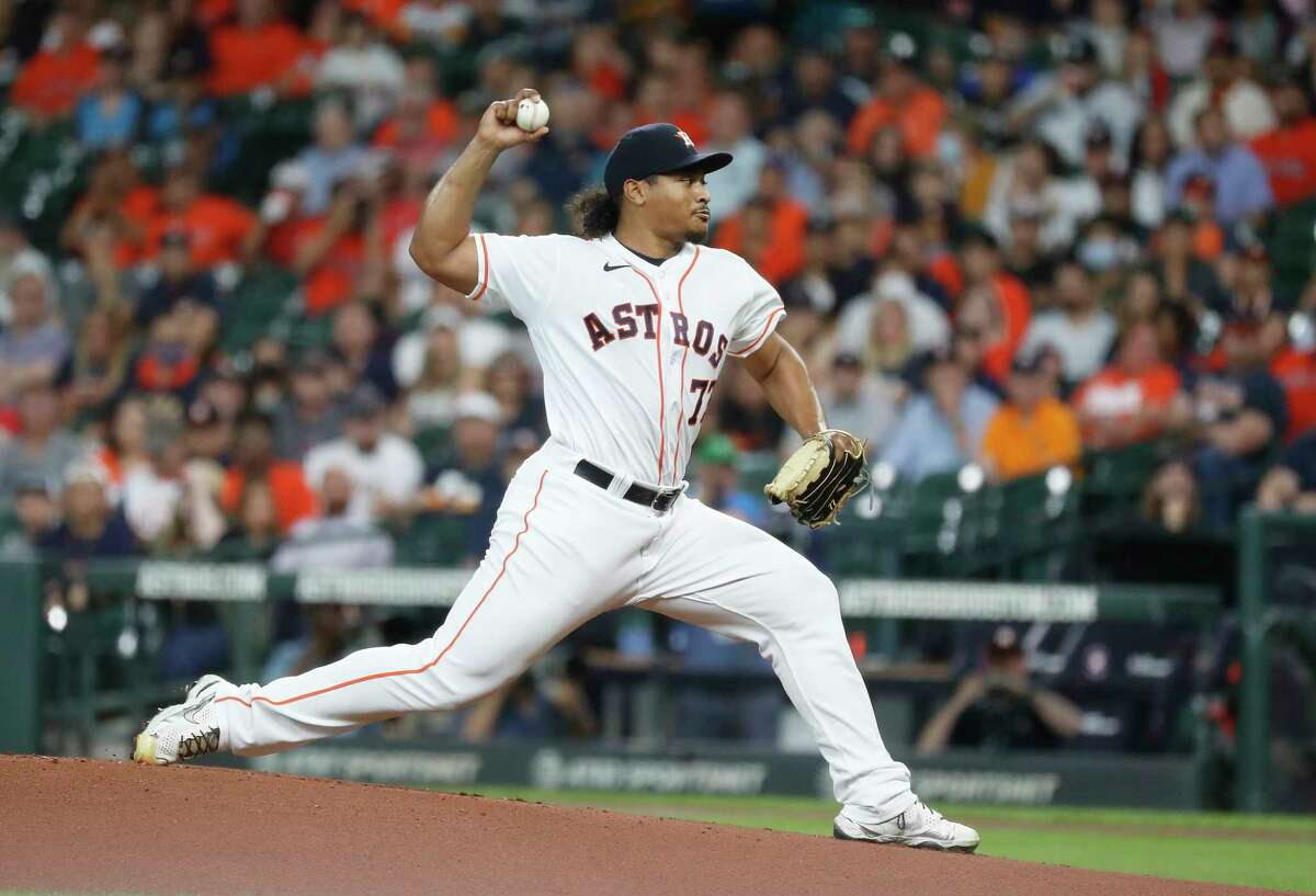 Houston Astros starting pitcher Luis Garcia (77) pitches during the first inning of an MLB baseball game at Minute Maid Park, Tuesday, June 1, 2021, in Houston.