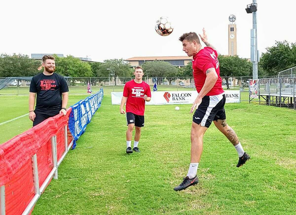 Lewis Wilson hits a header over the net that was set up by his teammate Liam Morrison during a game of soccer tennis after a Laredo Heat practice on Monday, May 31 at the TAMIU Soccer Complex.