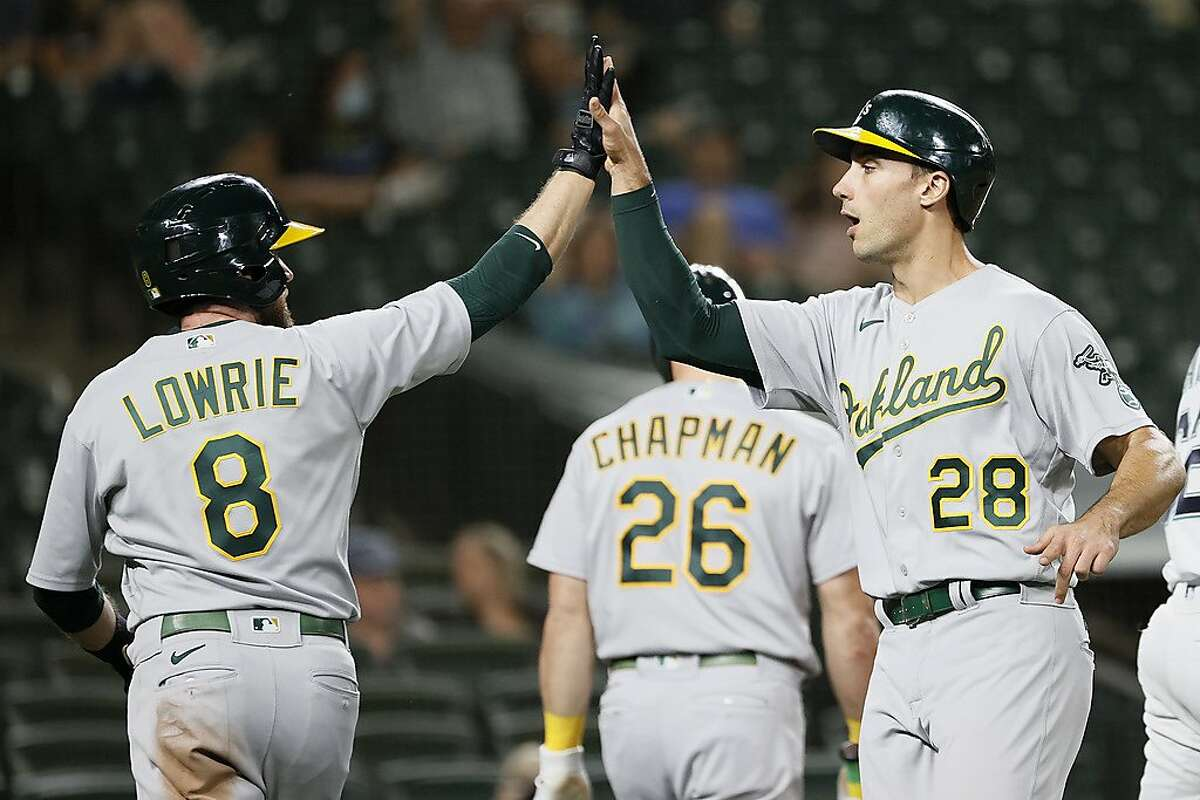 SEATTLE, WASHINGTON - JUNE 01: Jed Lowrie #8 and Matt Olson #28 of the Oakland Athletics celebrate a run against the Seattle Mariners during the seventh inning at T-Mobile Park on June 01, 2021 in Seattle, Washington. (Photo by Steph Chambers/Getty Images)
