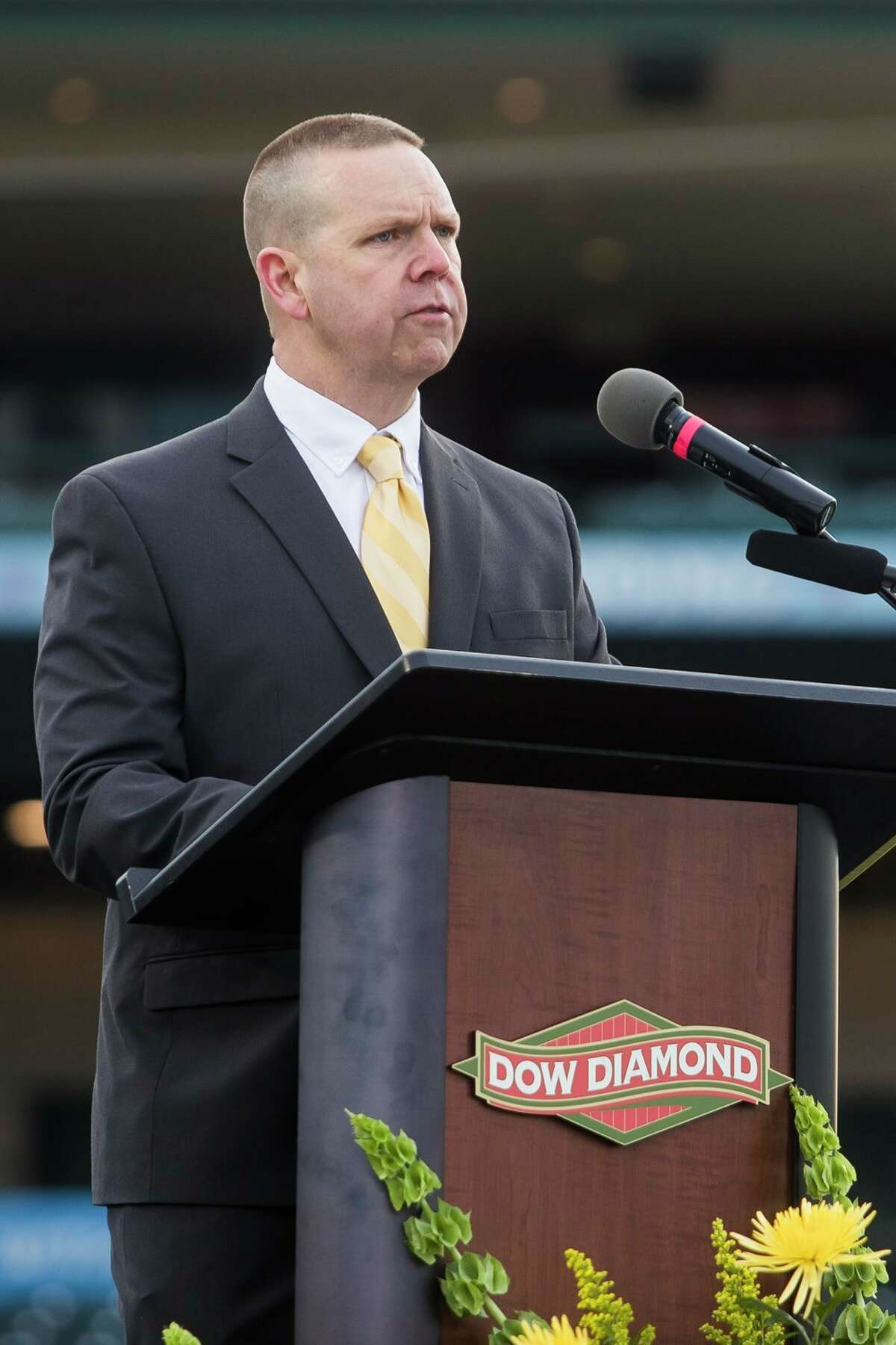 H. H. Dow High School Principal Ted Davis addresses the Class of 2021 as they celebrate with a commencement ceremony Friday at Dow Diamond in Midland. (Katy Kildee/kkildee@mdn.net)