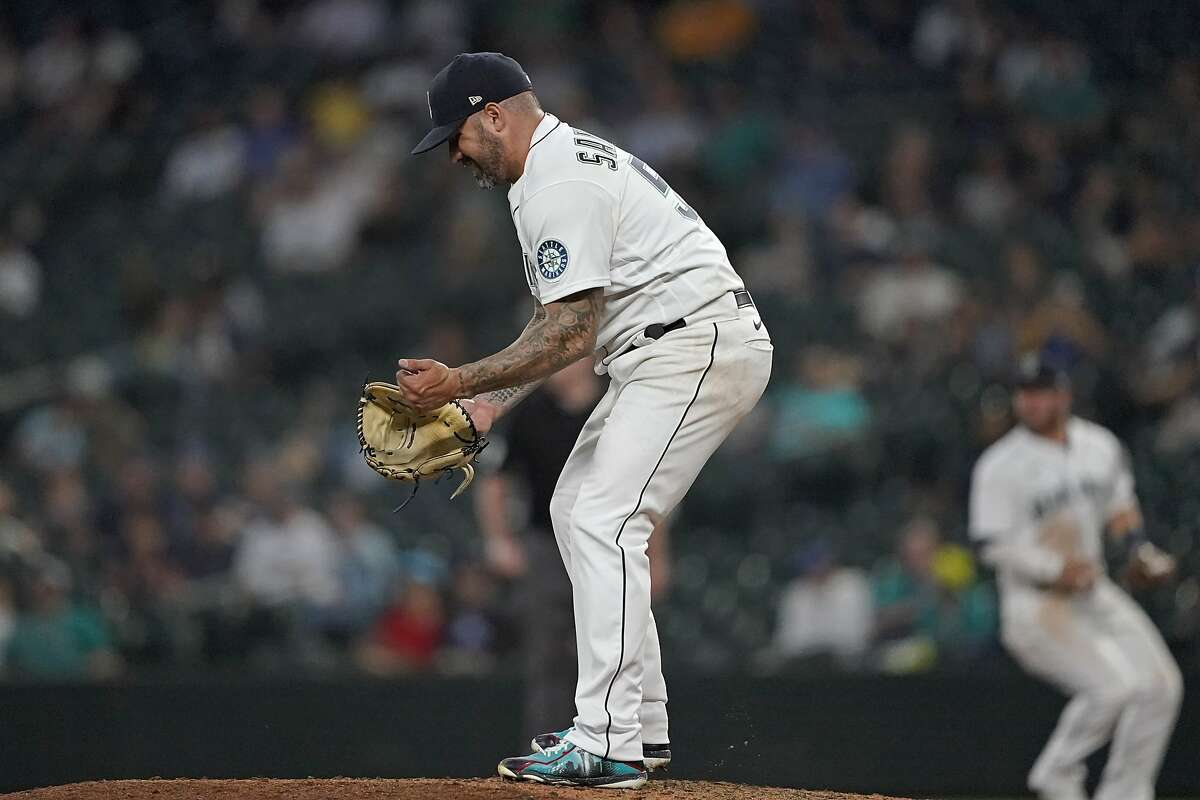 Seattle Mariners pitcher Hector Santiago reacts on the mound during the seventh inning of the team's baseball game against the Oakland Athletics, Tuesday, June 1, 2021, in Seattle. (AP Photo/Ted S. Warren)