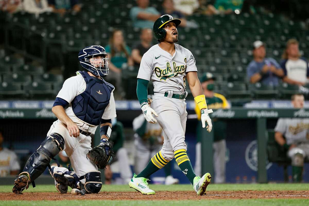 SEATTLE, WASHINGTON - JUNE 01: Tony Kemp #5 of the Oakland Athletics watches his two-run home run against the Seattle Mariners during the eighth inning at T-Mobile Park on June 01, 2021 in Seattle, Washington. (Photo by Steph Chambers/Getty Images)