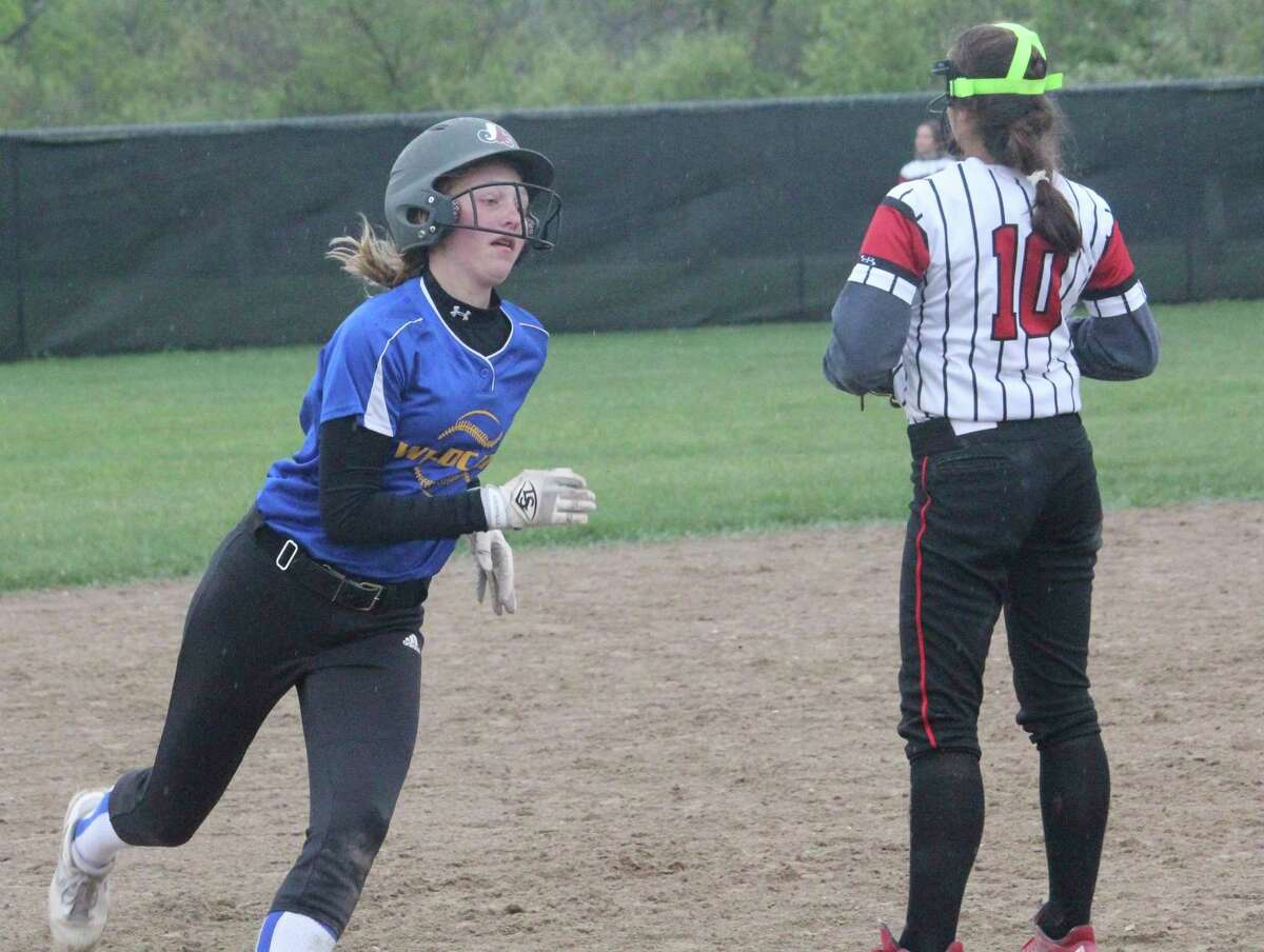 Evart's Addy Gray rounds third base and heads for home in Thursday's doubleheader with Reed City. (Herald Review phioto/John Raffel)