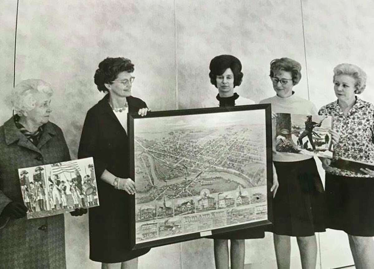 Mrs. W.E. Walles, second from left, president of the Midland Woman's Club, presents a framed map of Midland as it was in 1884, and two sets of historical pictures to Woodcrest Elementary School. Also representing the club is Mrs. C.E. Parker, left, and Mrs. Geroge Morrison, right. Accepting the material is Patricia McCallum, center, the school librarian, and Shirley Hansen, second from right. March 1970