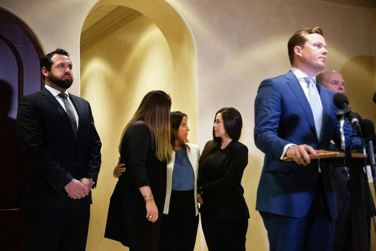 Jacquelyn Aluotto, center, talks to other plaintiffs after speaking to members of the press at a press conference about alleged sexual misconduct against female deputies in the Harris County Constable Precinct 1, Monday, May 24, 2021, in Houston.