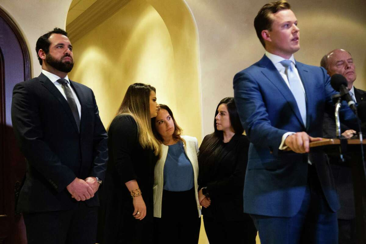 Jacquelyn Aluotto, center, rests her head on the shoulder of a plaintiff after speaking to members of the press at a press conference about alleged sexual misconduct against female deputies in the Harris County Constable Precinct 1, Monday, May 24, 2021, in Houston.