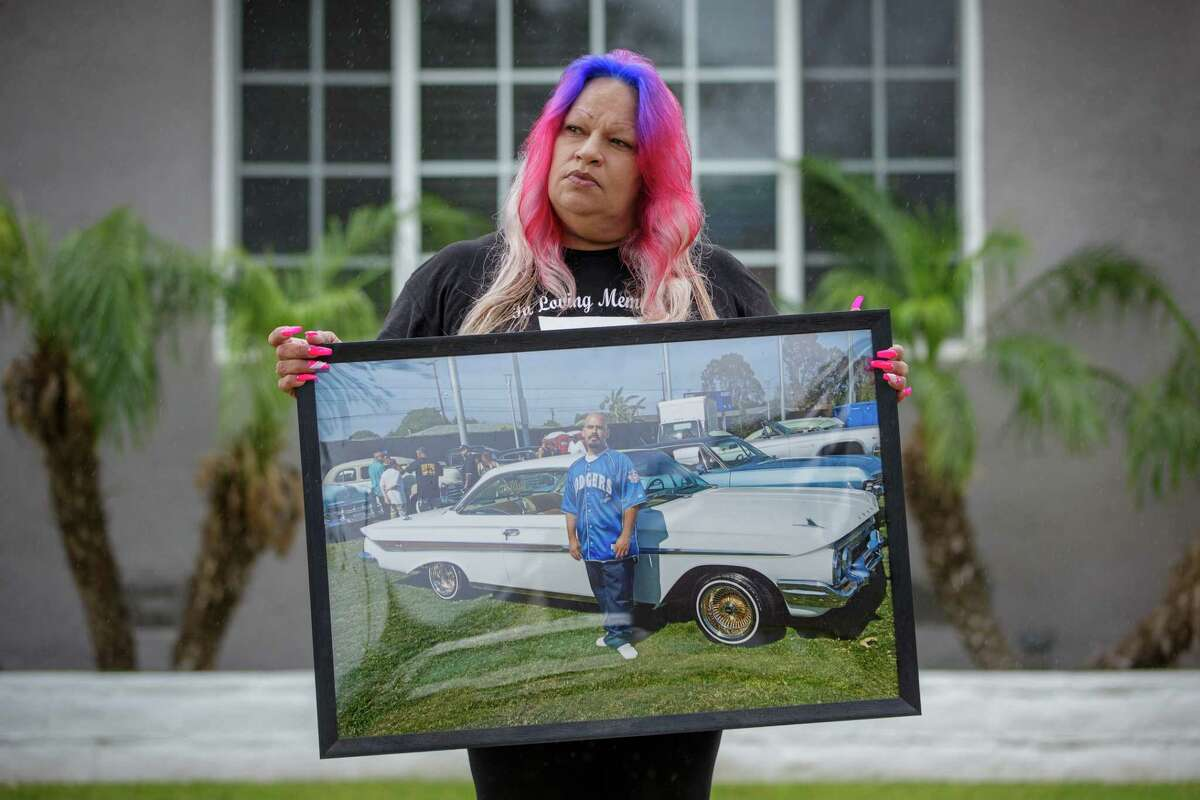 Maria Serrano holds a photo of her son Ernie Serrano in Los Angeles, Calif. on May 16, 2021. Serrano died at the age of 33 years old while in police custody.