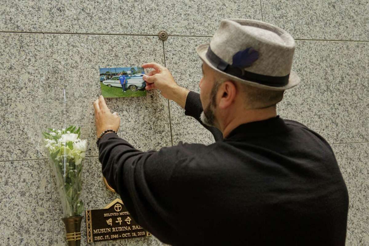 Serafin Serrano posts a photo of Ernie Serrano on his tomb while the family waits for his plaque to be completed in Culver City, Calif. on May 17, 2021.