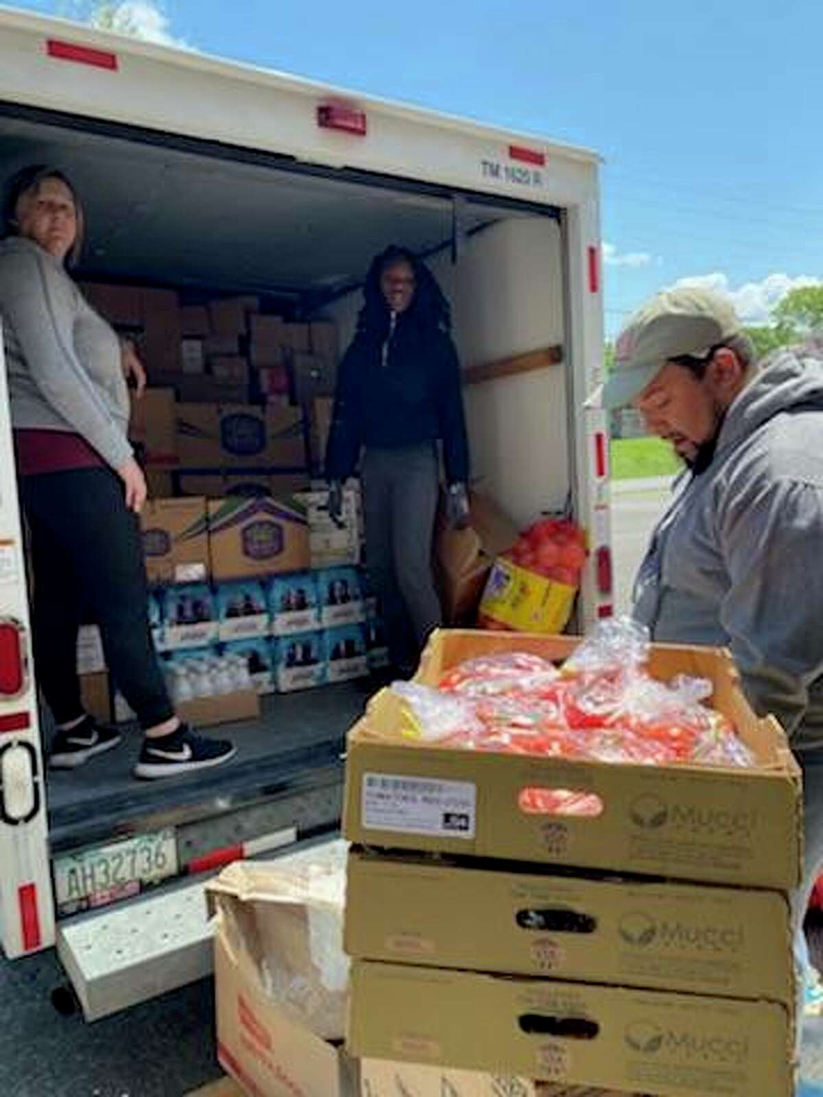 The Storehouse volunteers sort through food donations, including meat, produce and canned goods. A Friday opening is planned for the food pantry at 3420 College Ave., Alton.