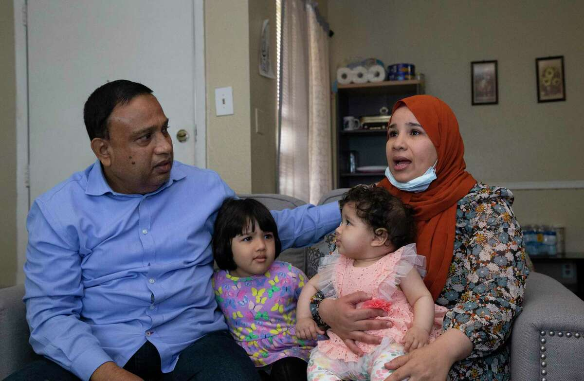 Khandaker Rahman, 55, comforts wife, Mabrouka Rahman, when she recalls the stress and fear when Rahman was accused of sexually assaulting a female Uber passenger Monday, April 26, 2021, in Houston. Between them are their daughters, Atay, 3, and Aliza, 7 months, whom Rahman was pregnant with when the accusation happened.
