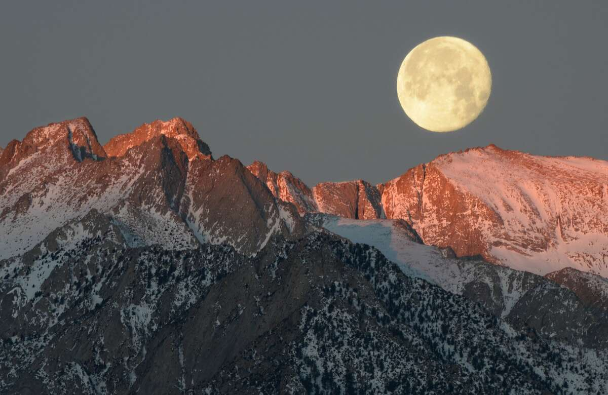 A beautiful moon rises over Mount Russell in California's Sierra Nevada mountains.