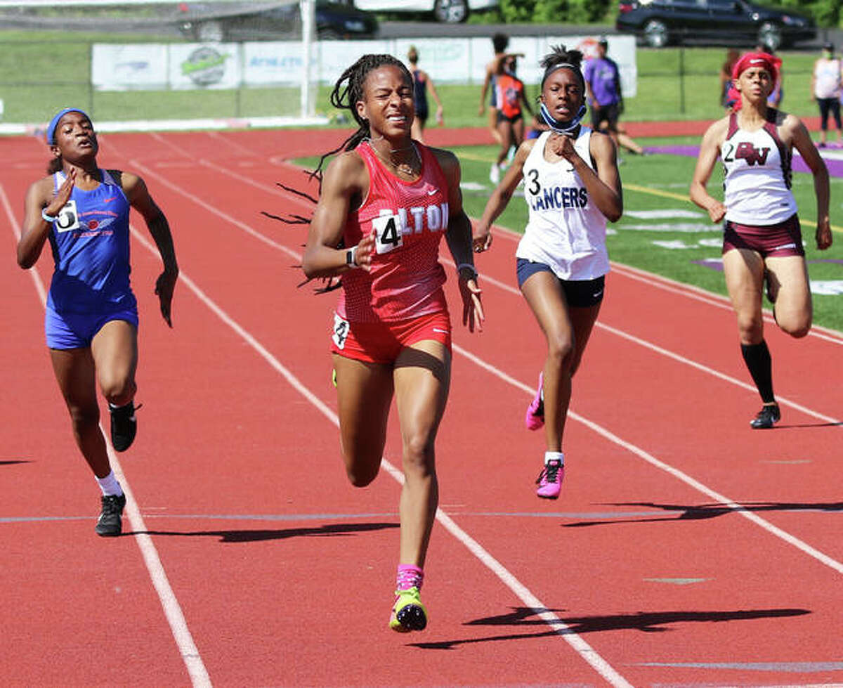 Alton's Renee Raglin approaches the finish ahead of East St. Louis' Sydney Jones (left) and Belleville East's DeAndranay (second right) and Belleville West's Aya Dunn (right) to win the 200 meters on May 26 at the SWC Meet in Collinsville.