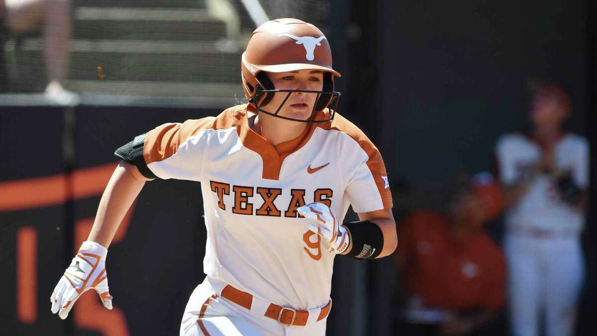 Texas batter McKenzie Parker (9) against Oklahoma State during an NCAA softball game on Saturday, May 29, 2021, in Stillwater, Okla. (AP Photo/Michael Woods)