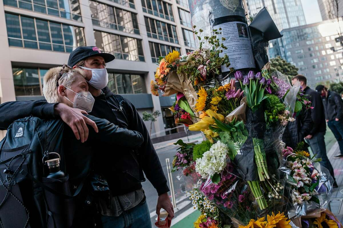 Claire Clayton and Will Toaspern embrace near a makeshift memorial on the corner of Polk and Hayes during a vigil honoring Lovisa Svallingson who was killed in a hit and run accident that also critically injured her boyfriend Danny Ramos in San Francisco on Wednesday, May 27, 2021.