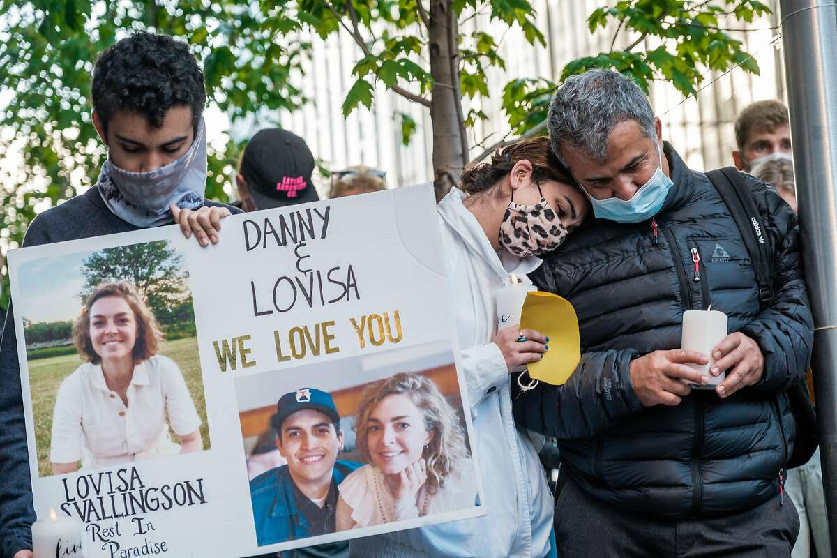 From left to right Kamron, Samantha and Amir the brother, sister, and father of Danny Ramos who was injured in a hit and run crash that also killed his girlfriend, Lovisa Svallingson attend a vigil on the corner of Polk and Hayes where the accident occurred in San Francisco on Wednesday, May 27, 2021.