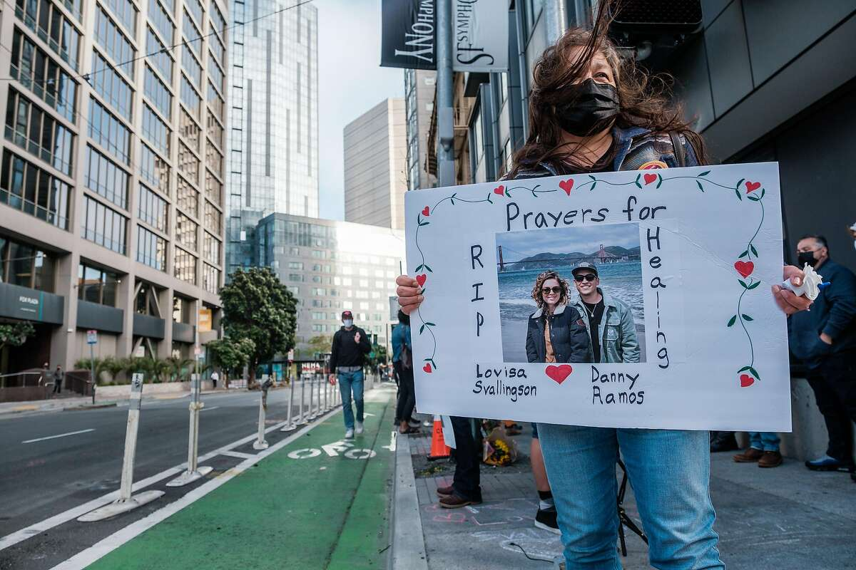 Maria Cortez holds a sign on the corner of Polk and Hayes while attending a vigil honoring Lovisa Svallingson who was killed in a hit and run accident that also critically injured her boyfriend Danny Ramos in San Francisco on Wednesday, May 27, 2021.
