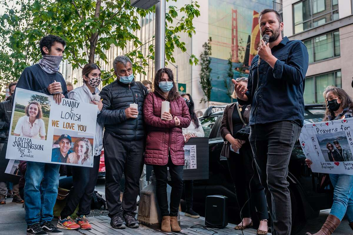The family of Danny Ramos who was injured in a hit and run crash that also killed his girlfriend, Lovisa Svallingson listen to Supervisor Matt Haney speak during a vigil on the corner of Polk and Hayes where the accident occurred in San Francisco on Wednesday, May 27, 2021.