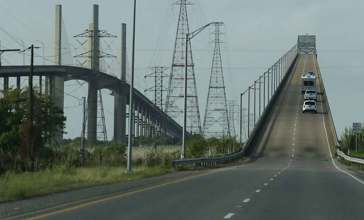 Car drive over Rainbow Bridge in Bridge City in preparation for Hurricane Laura on Wednesday, Aug. 26, 2020.
