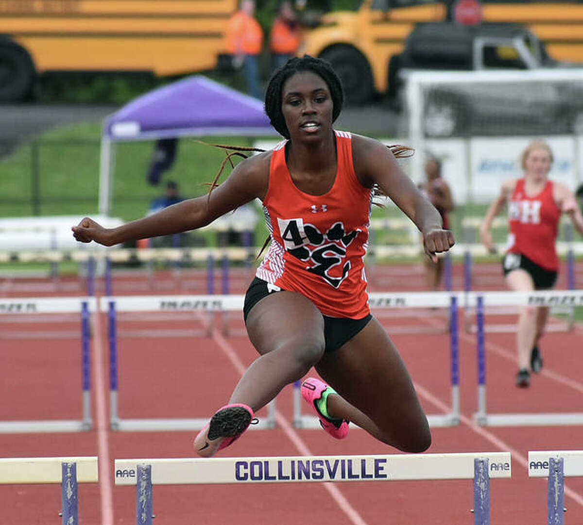 Edwardsville's Sydnee Campbell competes in the 300-meter hurdles during the Madison County Meet at Collinsville High School.