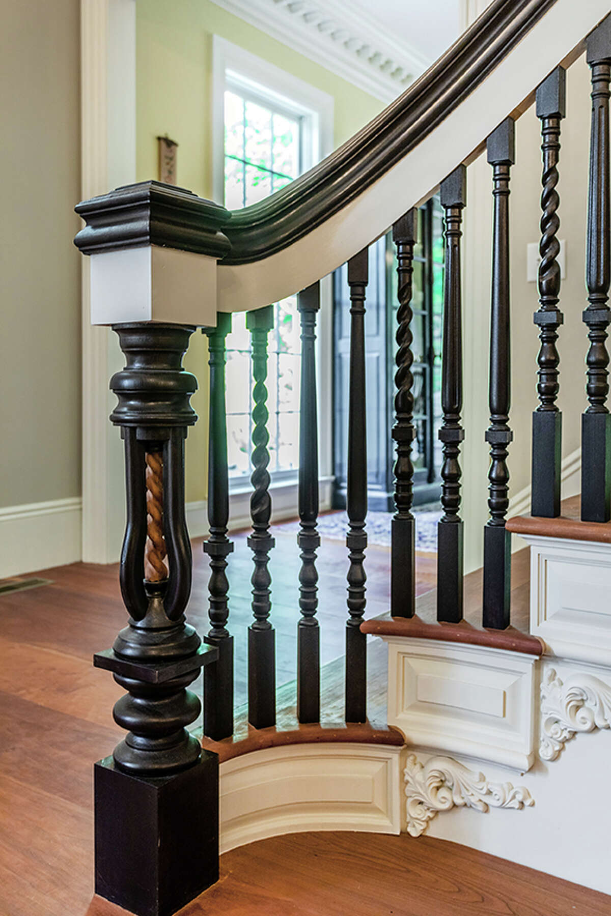 The stairs in the home on 92 Judds Bridge Road in Roxbury, Conn. is handmade and borrows from the design of sea captains' mansions of the Piscataqua River region of New Hampshire and Maine, according to the listing.