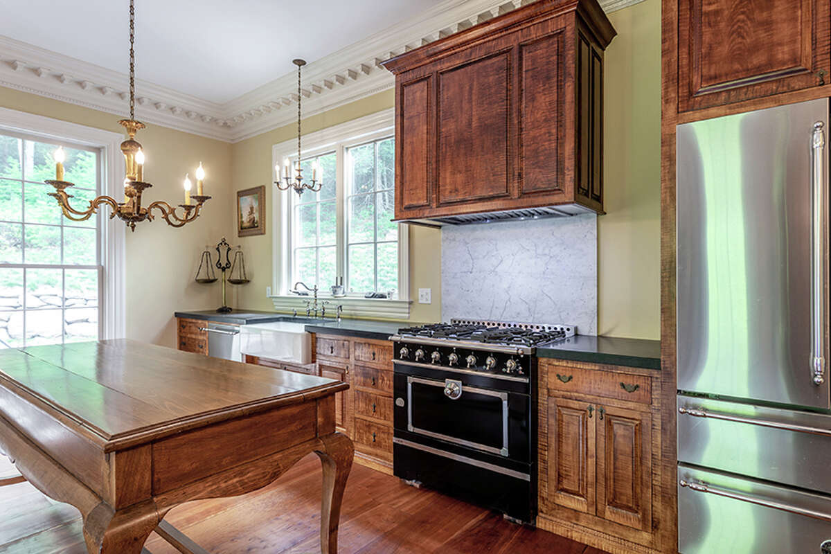 The kitchen in the home on 92 Judds Bridge Road in Roxbury, Conn. features country-style finishes, according to the listing.
