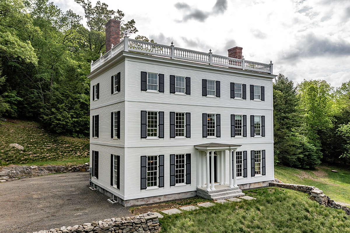 The exterior of the home on 92 Judds Bridge Road in Roxbury, Conn. maintains the exact proportions of the home on which it is based:the Governor WoodburyHouse in Portsmouth, N.H.