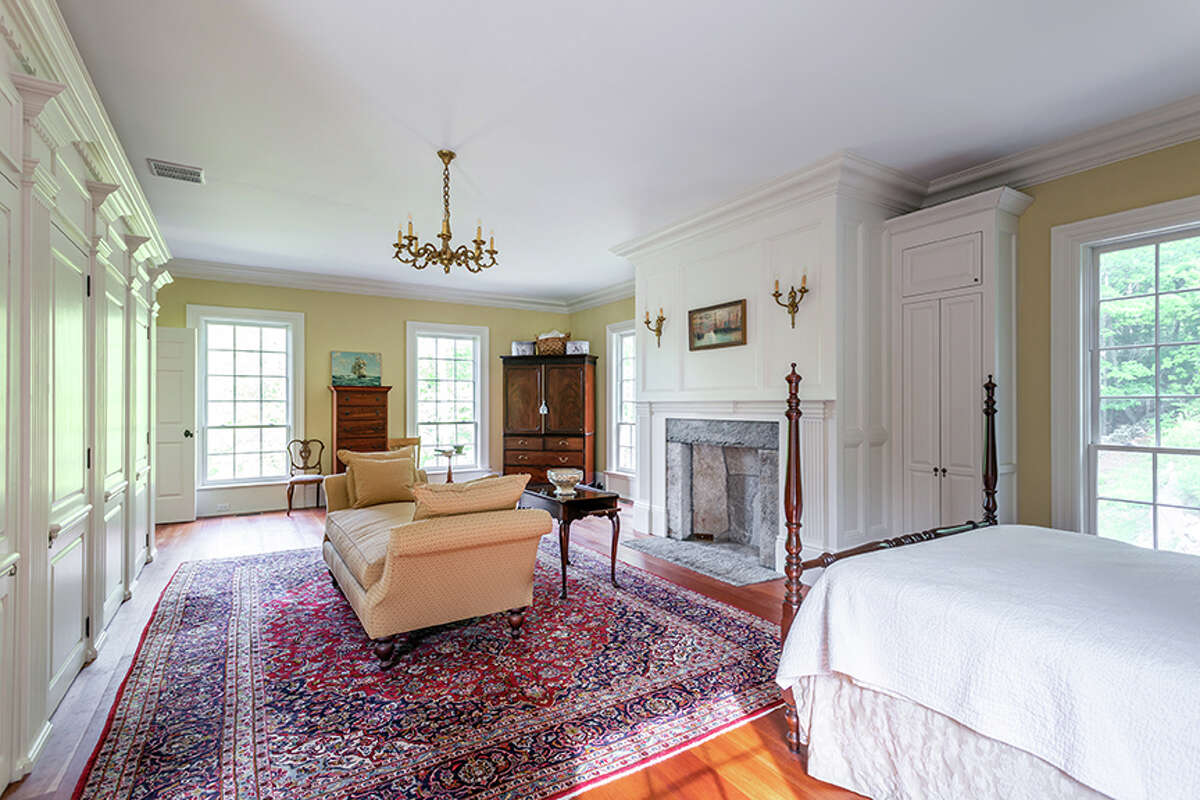 The master bedroom in the home on 92 Judds Bridge Road in Roxbury, Conn. has a fireplace and details that harken back to the original Governor LeviWoodburyHouse in Portsmouth, N.H.