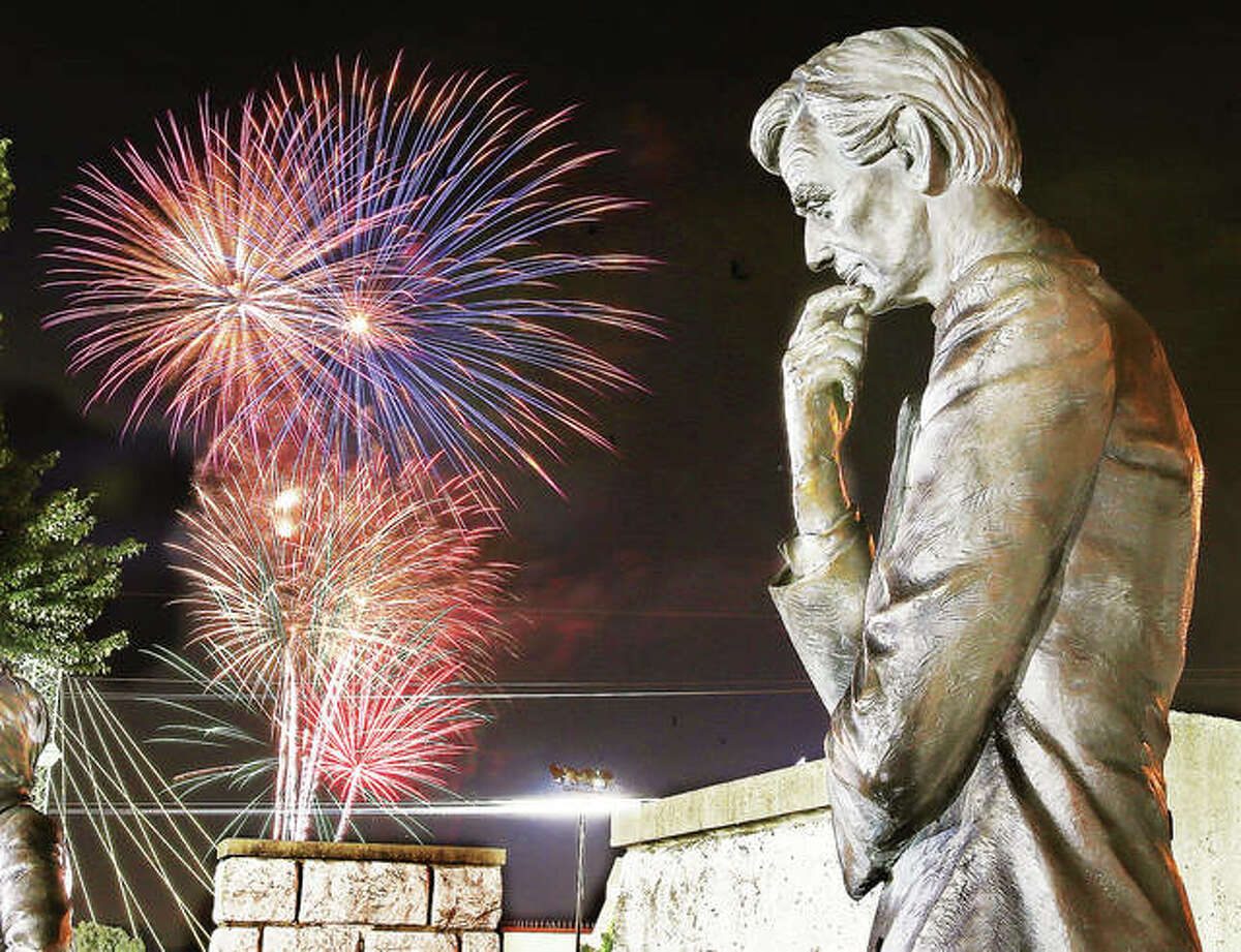 Fireworks explode on the Alton riverfront in 2018 in front of the Abraham Lincoln statue in Alton's Lincoln-Douglas Square. Free weekly fireworks start Thursday in Alton and Grafton.