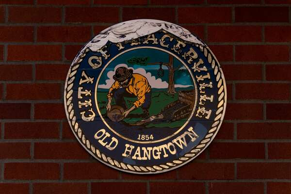 The Seal of the City of Placerville is seen on the exterior of City Hall.
