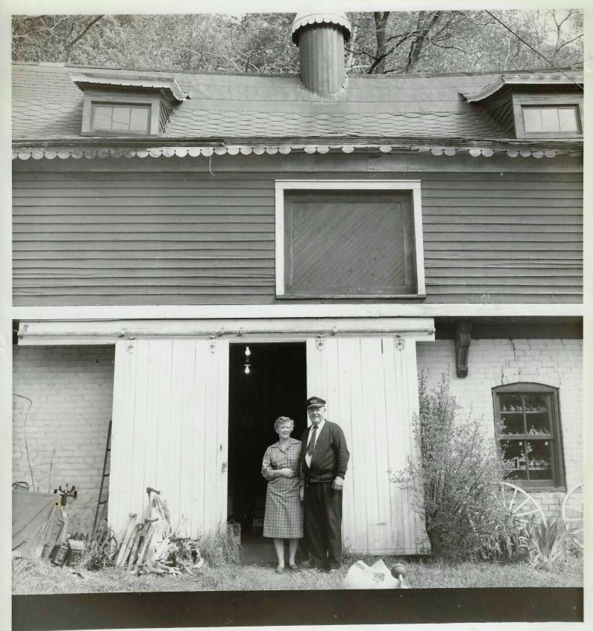 Captain Arthur Frederickson,one of the longest serving captains of the carferries,and his wife, Lucy, stand in front of their barn in Frankfort. (Courtesy photo)