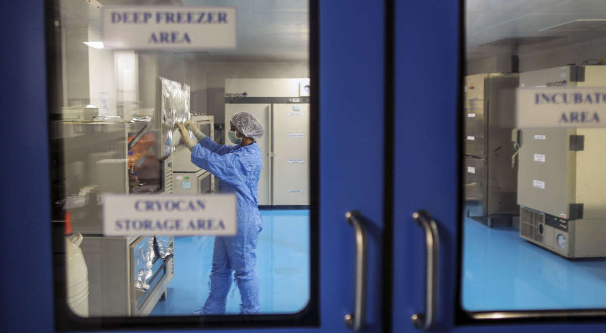 An employee in protective clothing works inside a deep freezer area of the research and development center at the Biocon Ltd. campus in Bengaluru, India, on Nov. 16, 2016.