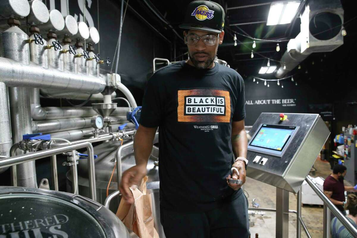 Weathered Souls Brewing Co. founder and brewer Marcus Baskerville prepares to brew a batch, Friday, May 28, 2021. One year ago, he started the Black is Beautiful stout beer campaign, that has gone internationally, to raise awareness to the injustices people of color face.