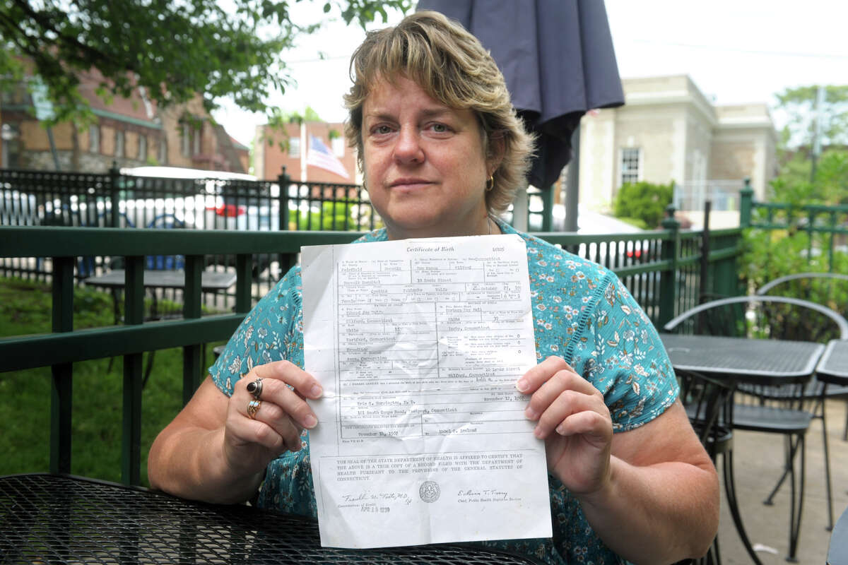 Cindy Boynton holds a copy of her birth certificate during an interview in Milford, Conn. June 2, 2021.