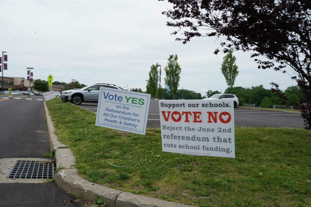 """Residents from around town are filing in to the New Canaan High School parking lot to cast their ballot, either """"yes"""" or """"no"""" on a referendum attempt on the Board of Education budget."""