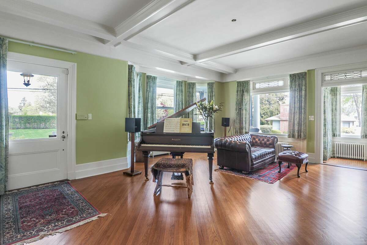 The entry and living room of the home on 137 Hubbard Avenue in Stamford, Conn. shows off the property's original details, which have been restored and maintained.