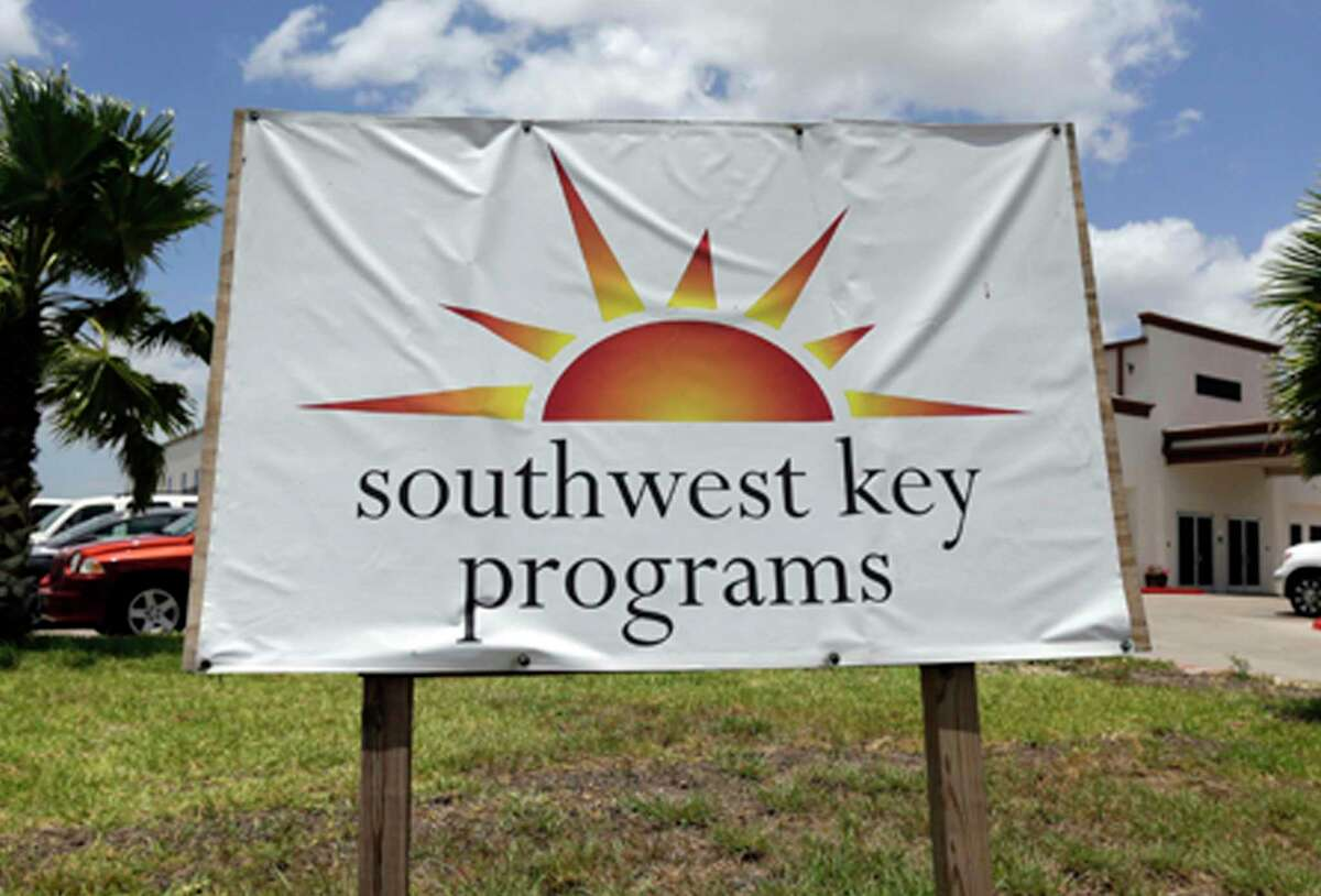 This June 20, 2014, file photo shows a Southwest Key Programs sign in Brownsville, Texas. The U.S. Department of Health and Human Services had awarded a $79 million contract to the nonprofit organization to provide child care and case management services at one of the new child migrant facilities in Midland, Texas.
