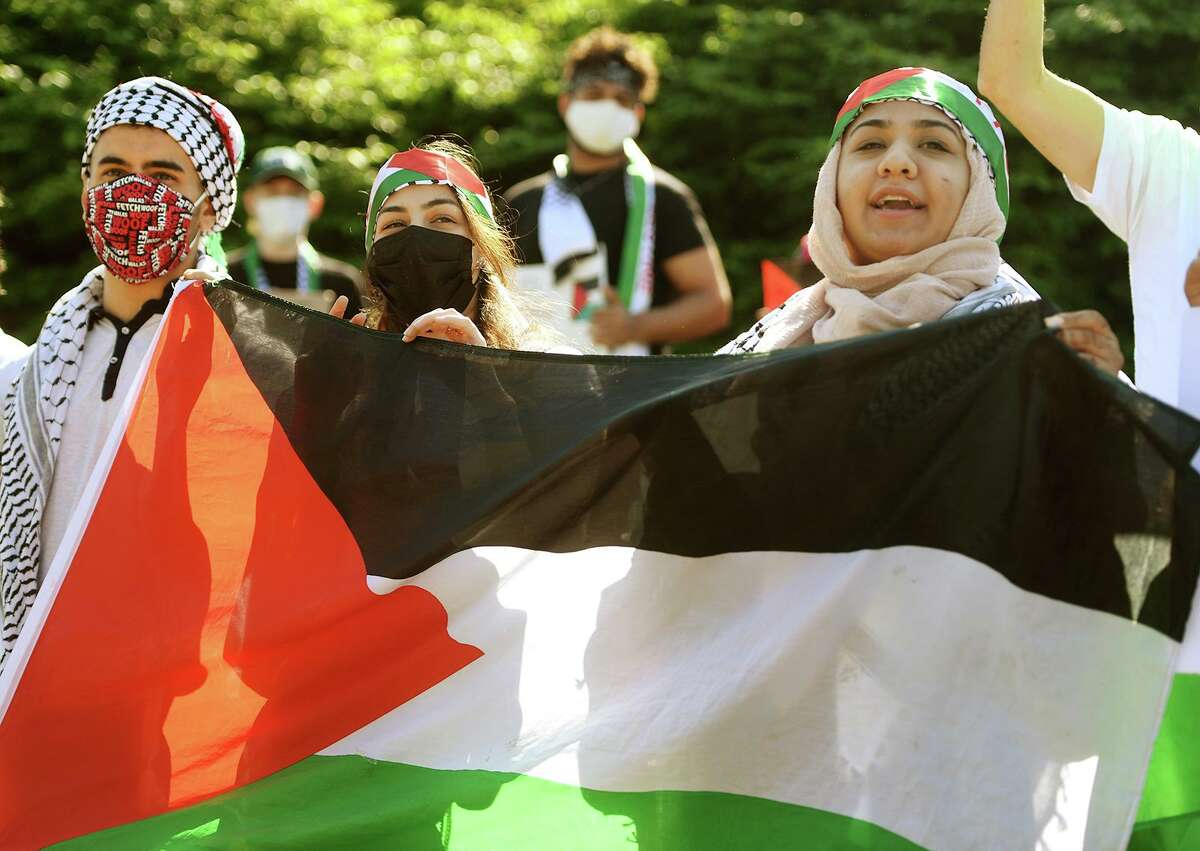 Palestinians and their supporters protest Israel's recent actions in Gaza outside President Biden's appearance at the Coast Guard Academy graduation ceremony in New London Conn. on Wednesday, May 19, 2021.